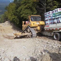 McCarey's Bulldozer and Truck on Pipeline